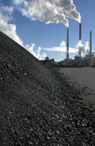 Coal piled near a power plant.
